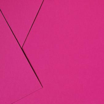 Fundo abstrato rosa inspirado pelo design de material com papelão e papel