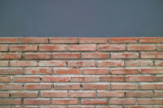 Fundo abstrato, tijolo velho com parede do cimento.