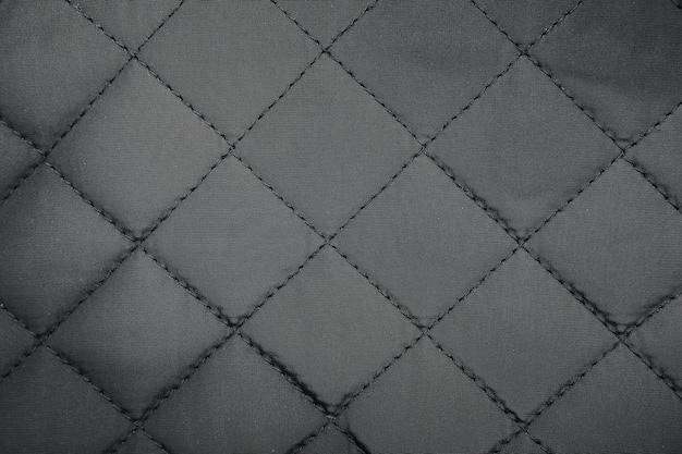 Fundo acolchoado de textura de tecido sintético.