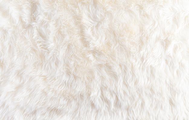 Fundo aconchegante de inverno feito de tapete de lã com espaço, vista superior.