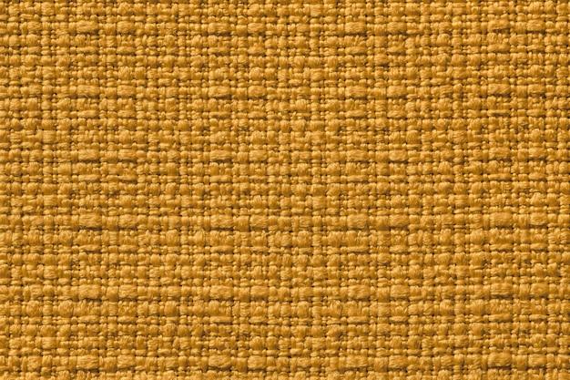 Fundo amarelo escuro de um material têxtil