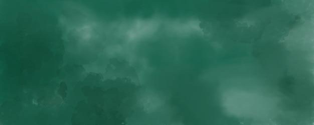 Fundo aquarela na cor verde, respingos de cor pastel suave e manchas com pintura de sangramento de franjas em formas abstratas de nuvens com papel