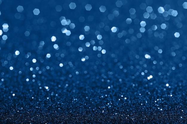 Fundo azul abstrato com bokeh cintilante. cor do ano 2020.