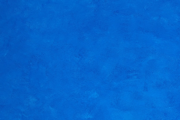 Fundo azul brilhante decorativo bonito com textura áspera agradável para design e decoração.