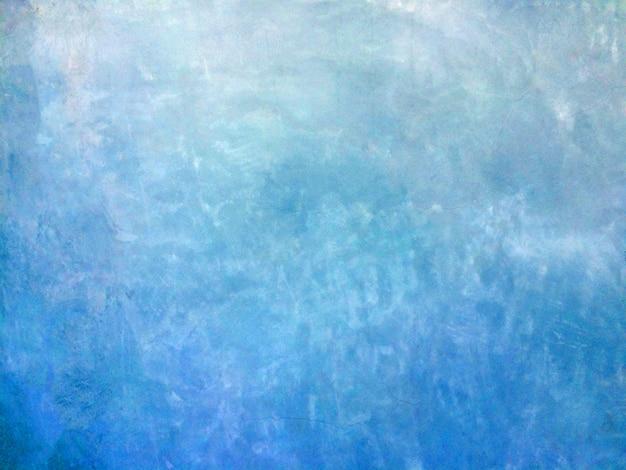 Fundo azul da parede do cimento com espaço livre para o texto.
