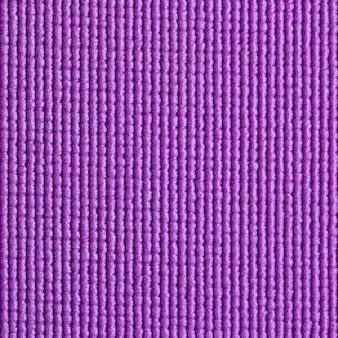 Fundo azul da textura da esteira de ioga