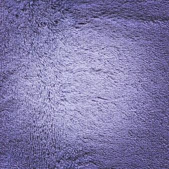 Fundo azul da textura da superfície de toalha. textura de toalha azul áspera
