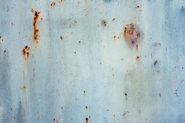 Fundo azul da textura do ferro do grunge, fundo do metal com riscos. metal azul grunge velho enferrujado arranhou a textura da superfície