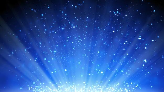 Fundo azul de partículas de brilho