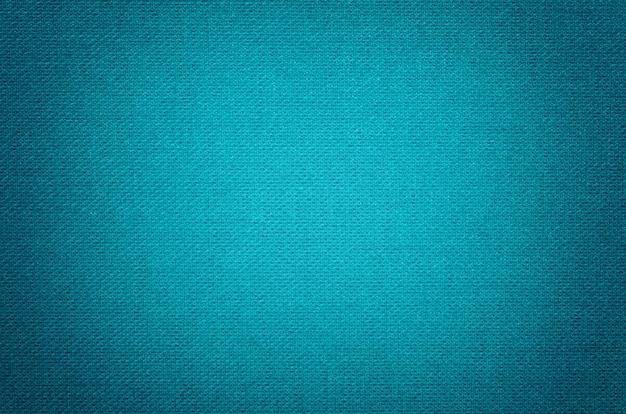 Fundo azul de um material têxtil com teste padrão de vime, close up.