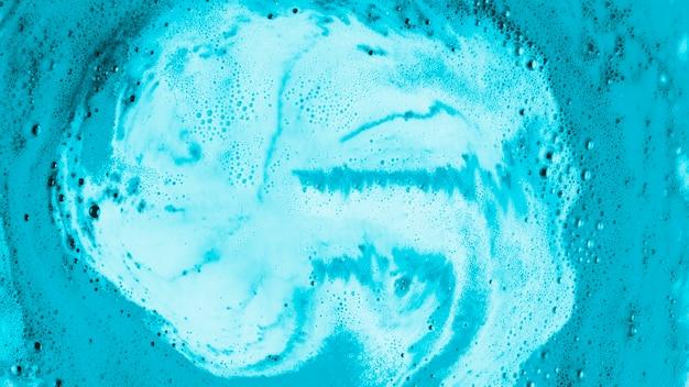 Fundo azul do banho de espuma do cuidado do corpo