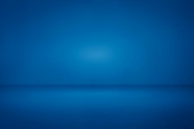 Fundo azul do inclinação da luz do estúdio da sala nós para o contexto