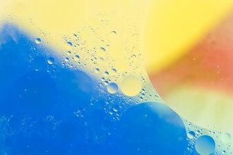 Fundo azul e amarelo com padrão de bolha