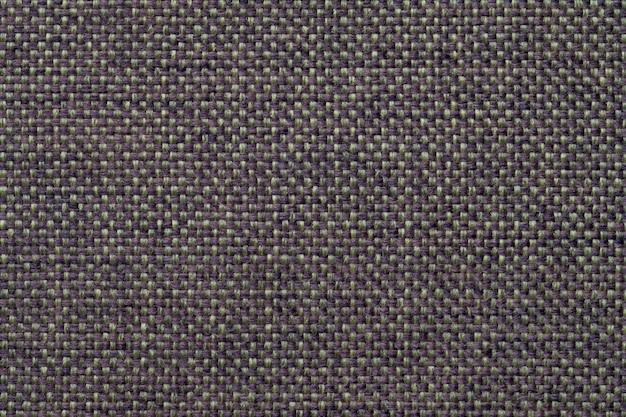 Fundo azul e verde de matéria têxtil com projeto quadriculado, close up. estrutura da macro de malha.