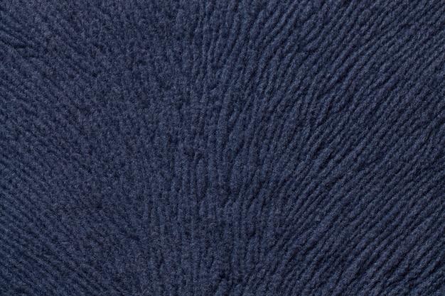 Fundo azul escuro de material têxtil suave, tecido com textura natural,