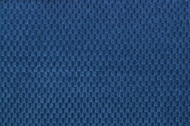 Fundo azul escuro de tecido fofo macio closeup