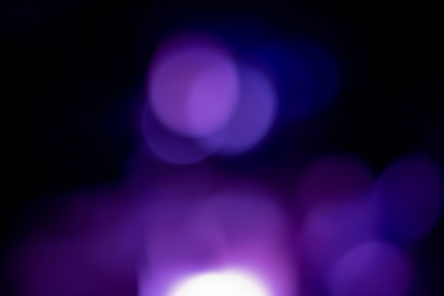 Fundo azul marinho brilho prata natal textura luz abstrata estrelas cintilantes no bokeh. fundo de luzes vintage brilhantes