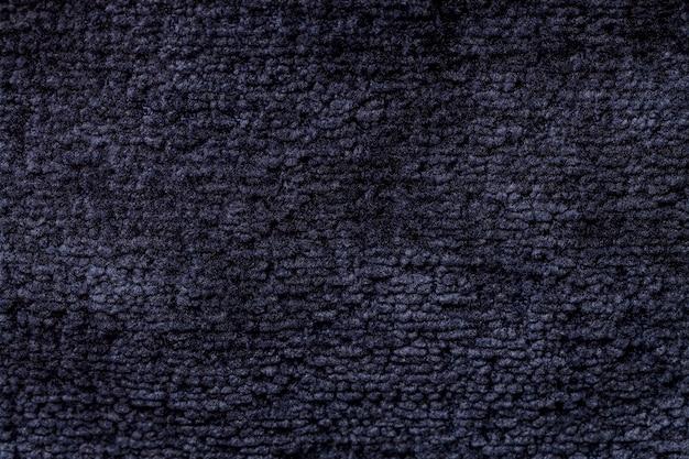 Fundo azul marinho com tecido macio e tecido com textura natural