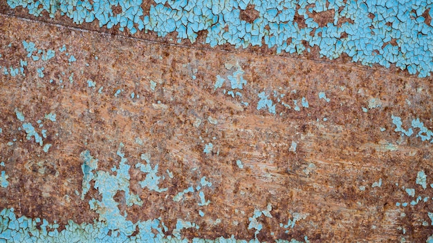 Fundo azul velho com desenho enferrujado
