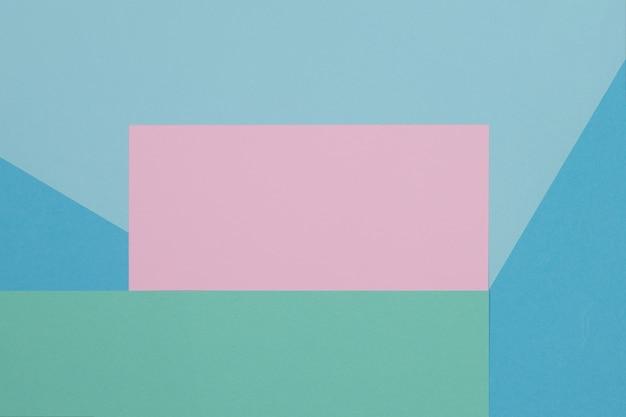 Fundo azul, verde e rosa, papel colorido divide-se geometricamente em zonas