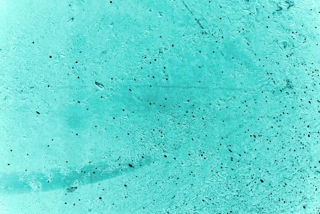 Fundo azul vintage. parede áspera pintada de cor turquesa. plano imperfeito de cor ciano. desigual velho decorativo tonificado pano de fundo de tonalidade aqzure. textura de tonalidade verde-azulado. superfície pedregosa ornamental.