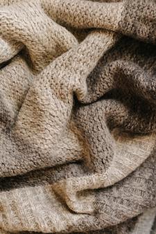 Fundo bege de textura de lã de tricô de outono.