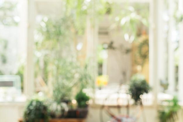 Fundo borrado - coffee shop em fundo de borrão de jardim com bokeh. vintage filtrou a imagem.