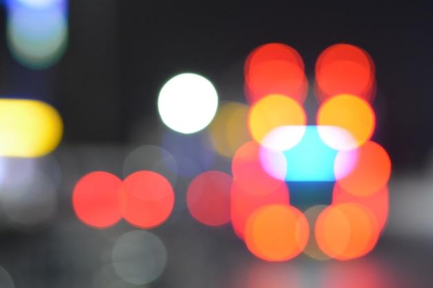 Fundo borrado do bokeh da luz do carro