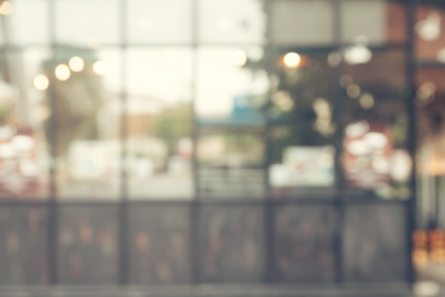 Fundo borrado - filtro vintage cliente na loja de café desfocam o fundo com bokeh.