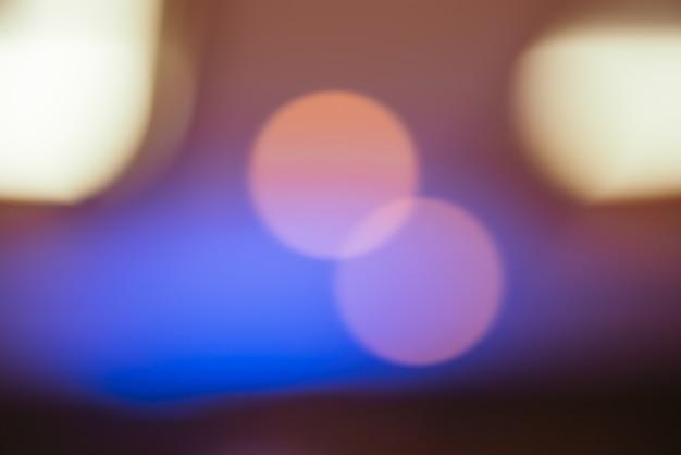 Fundo borrado: iluminação bokeh de círculo abstrato, fundo de textura, imagem filtrada vintage.