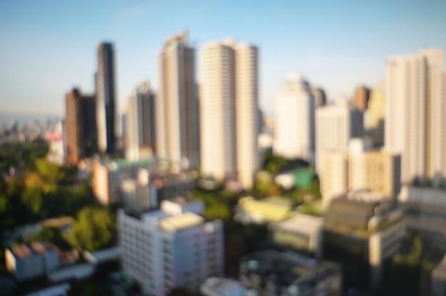 Fundo borrado sumário da skyline da arquitectura da cidade da construção.