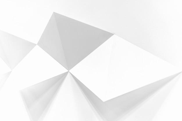 Fundo branco com quadrados saindo da parede e criando um efeito 3d