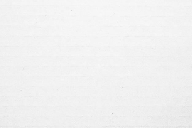 Fundo branco com textura de papelão reciclado