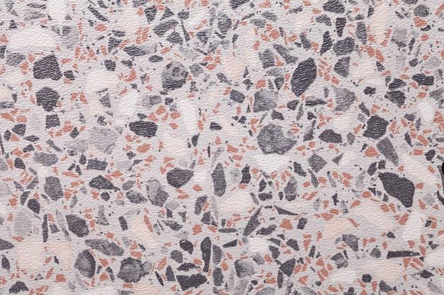 Fundo branco da arte abstrata. pintura em aquarela sobre tela com manchas pretas e marrons. piso em mosaico de padrão de seixos pequenos.