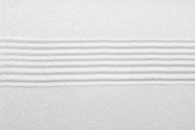 Fundo branco de areia zen em conceito de paz