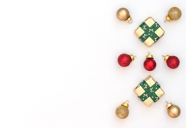 Fundo branco de natal com duas caixas de presente embrulhado com fita verde e bolas de natal.