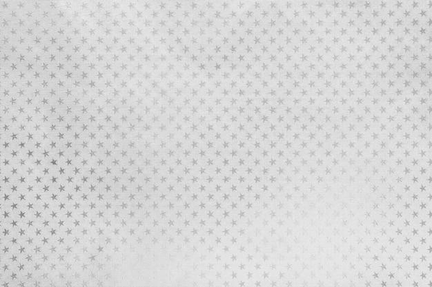 Fundo branco de papel de folha de metal com um padrão de estrelas