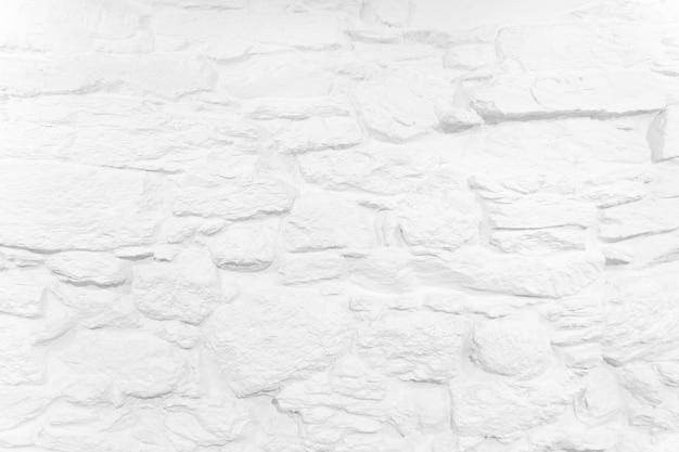 Fundo branco fundo da parede de pedra caiada textura áspera