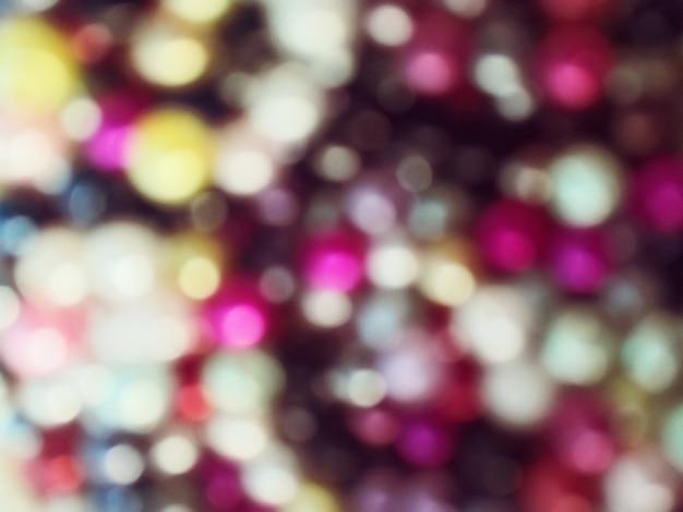Fundo brilhante e espumante bokeh. colorido - iluminação borrada da textura do brilho.