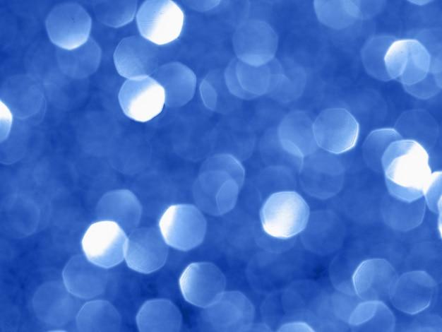 Fundo cintilante com bokeh feito da cor azul.