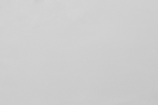 Fundo cinza claro com pequenos brilhos e textura. (foco macro na microtextura)