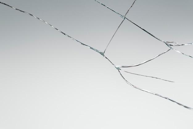 Fundo cinza com textura de vidro rachado