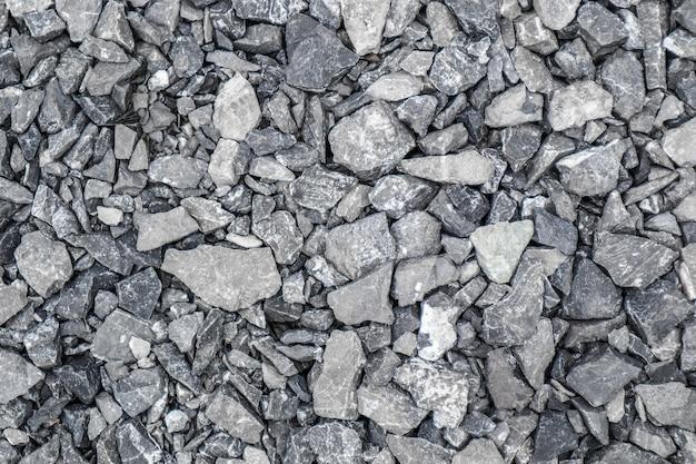 Fundo cinza de entulho de pedra de muitas pedras pequenas.