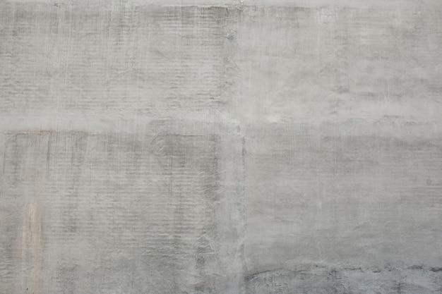Fundo cinza de parede de cimento rústico
