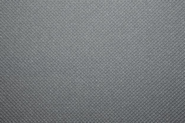 Fundo cinza de textura de esteira de ioga. fundo do tapete de acampamento