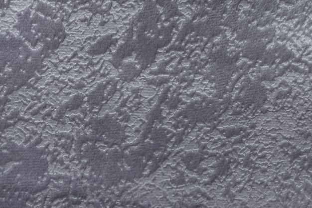 Fundo cinza de um material têxtil estofado macio,