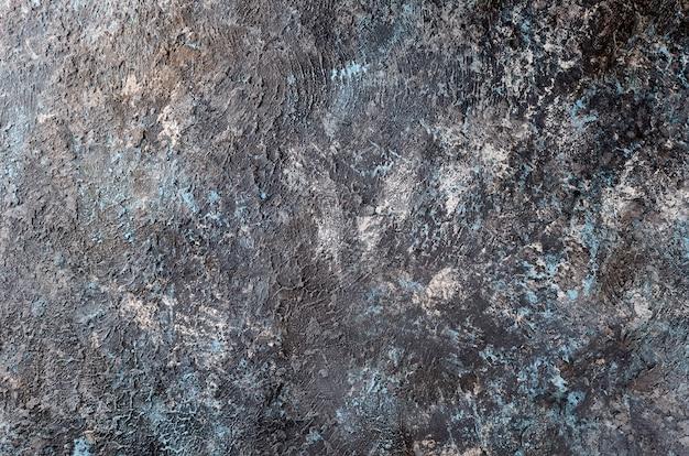Fundo cinza escuro com textura azul parede de concreto