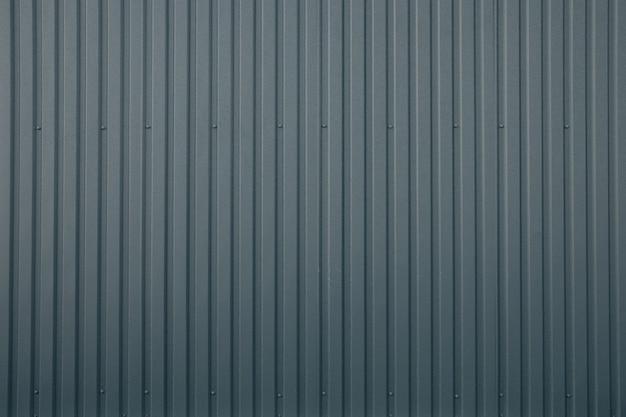 Fundo cinza listrado da parede metálica