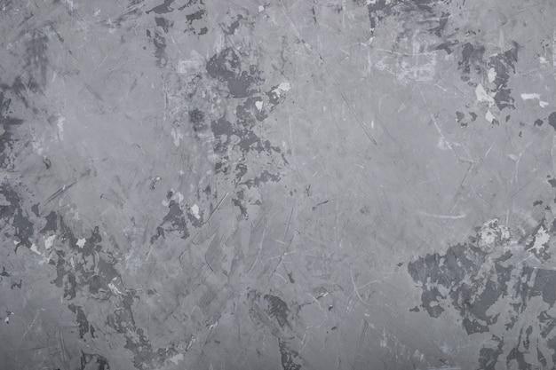 Fundo cinzento concreto da textura da parede do grunge abstrato.