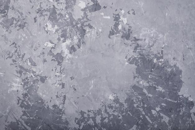 Fundo cinzento da textura da parede do grunge abstrato, tonificado.